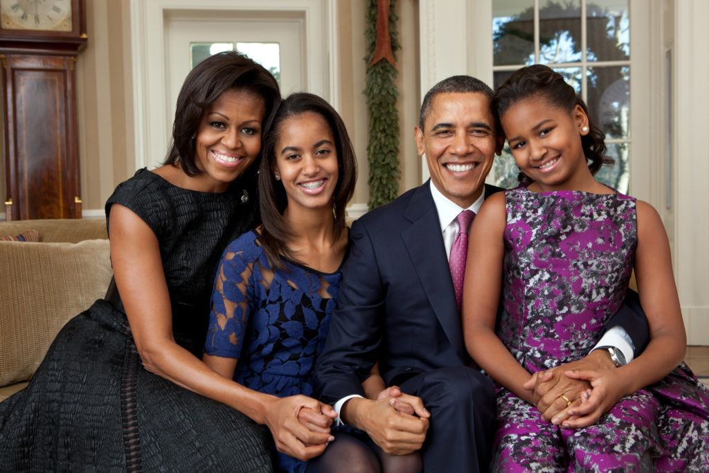 President Barack Obama, First Lady Michelle Obama, and their daughters, Sasha and Malia, sit for a family portrait in the Oval Office, Dec. 11, 2011. (Official White House Photo by Pete Souza)  This official White House photograph is being made available only for publication by news organizations and/or for personal use printing by the subject(s) of the photograph. The photograph may not be manipulated in any way and may not be used in commercial or political materials, advertisements, emails, products, promotions that in any way suggests approval or endorsement of the President, the First Family, or the White House.Ê